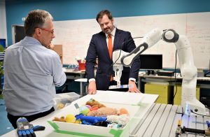 Centre Director Peter Corke demonstrating the Franka-Emika Panda arm to Hon Ed Husic MP